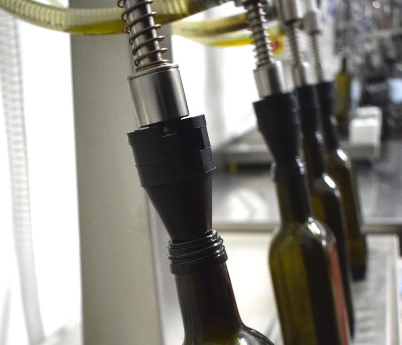 riempimento extravergine di oliva per imbottigliamento olio conto terzi